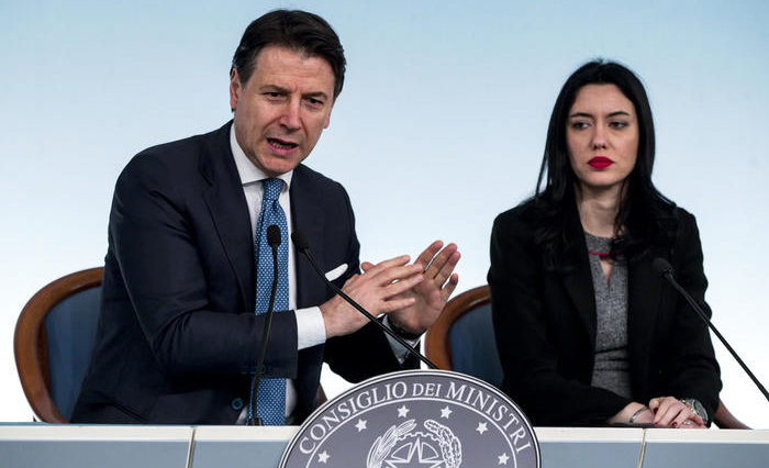 Italian Prime Minister Giuseppe Conte (L) with Italian Education Minister Lucia Azzolina (R) during a press conference about Italy's coronavirus emergency situation at Chigi palace, Rome, 04 March 2020. The government has decided to close schools and universities until mid-March to reduce the risk of contagion of the coronavirus.  ANSA/ANGELO CARCONI